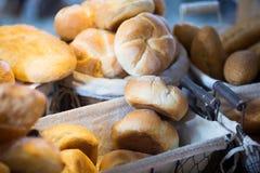 Fresh round scones at bakery display Stock Photos