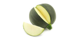 Fresh round zucchini and a cut piece Royalty Free Stock Image