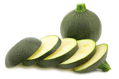 Fresh round zucchini and some slices Stock Image