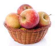Fresh royal gala apples in a basket. Isolated on white Stock Photo