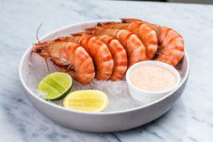 Fresh royal prawns with lemon and sauce. Served with the crushed ice Stock Photo