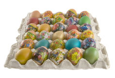Fresh rpainted eggs. Fresh rural painted eggs are decorated by various techniques before Easter packed into cardboard container Stock Photo