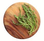Fresh Rucola on a round wooden board. Fresh Green Rucola on a round wooden board Stock Image
