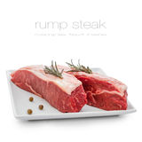 Fresh rump steaks with rosemary on plate Stock Photos