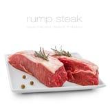 Fresh rump steaks with rosemary on plate Stock Photos