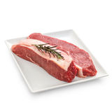 Fresh rump steaks with rosemary twig Royalty Free Stock Photo