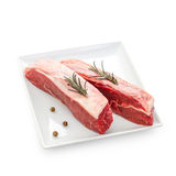 Fresh rump steaks with rosemary twig Stock Photography