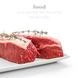 Fresh rump steaks with thymine twig isolated Royalty Free Stock Photography