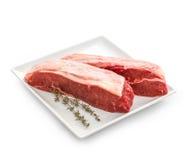 Fresh rump steaks with thymine twig Royalty Free Stock Image