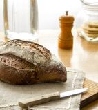 Fresh Rustic bread on the Wooden cutting board Royalty Free Stock Photos