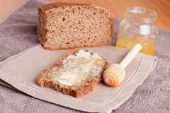 Fresh rye bread, butter and honey, close up, horizontal. Fresh rye bread, butter and honey Royalty Free Stock Image