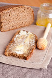 Fresh rye bread, butter and honey, vertical, honey. Fresh rye bread, butter and honey Royalty Free Stock Photo