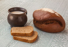 Fresh rye bread on the French recipe and a mug of milk Stock Photography
