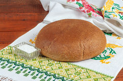 Fresh rye bread on old wooden table.  Stock Photo