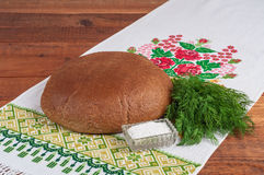 Fresh rye bread on old wooden table.  Royalty Free Stock Photos