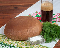 Fresh rye bread on old wooden table.  Royalty Free Stock Photography