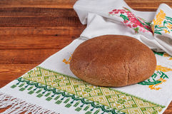 Fresh rye bread on old wooden table.  Stock Photos