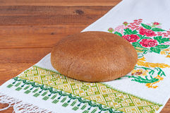 Fresh rye bread. On old wooden table Stock Images