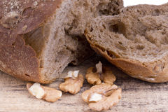 Fresh rye bread with walnuts on wooden background Royalty Free Stock Photo