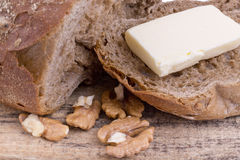 Fresh rye bread with walnuts on wooden background Stock Photography