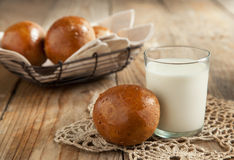 Fresh rye buns and glass of milk Stock Photography
