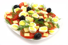 Fresh salad. A fresh salad with tomatoes, eggs, cheese and black olives Royalty Free Stock Photos