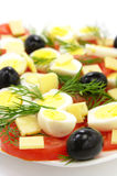 Fresh salad. A fresh salad with tomatoes, eggs, cheese and black olives Royalty Free Stock Image