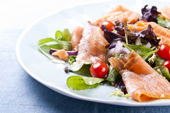 Fresh salad. Fresh smoked salmon salad with lettuce tomato and dressing stock photo