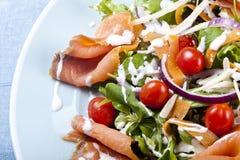 Fresh salad. Fresh smoked salmon salad with lettuce tomato and dressing royalty free stock photo
