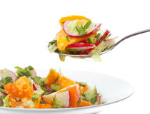 Fresh salad. Fresh vegetable salad on white background Stock Photo