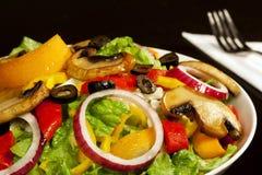 Fresh salad. On black background royalty free stock photo