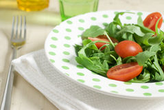 Fresh salad. Salad with tomatoes and rocket Stock Photos