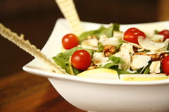 Fresh salad. Appetizing fresh salad with green lettuce and cherry tomatoes Royalty Free Stock Image
