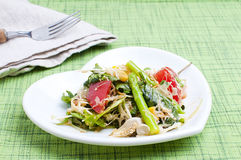 Fresh salad. Salad with green leaves, asparagus and tomatoes Royalty Free Stock Images