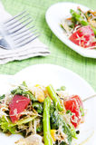 Fresh salad. Salad with green leaves, asparagus and tomatoes Stock Photography