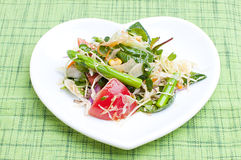 Fresh salad. Salad with green leaves, asparagus and tomatoes Stock Photo