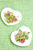 Fresh salad. Salad with green leaves, asparagus and tomatoes Stock Images
