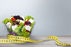 Free Fresh Salad And Measuring Tape, Close-up View Royalty Free Stock Photo - 108887665