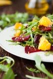 Fresh salad with arugula and citrus, healthy food Royalty Free Stock Photos