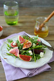 Fresh salad with arugula, figs and honey Royalty Free Stock Photos