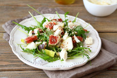 Fresh salad with arugula, figs, sliced cheese and pears Royalty Free Stock Photography