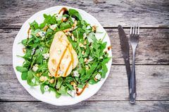 Fresh salad with arugula, pear, walnuts and blue cheese Stock Photography