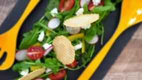 Salad of arugula, pepper, radish, tomato.