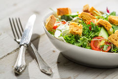 Fresh salad with arugula and tomatoes Stock Photo
