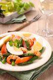 Fresh salad with asparagus, eggs, shrimp and tomatoes Royalty Free Stock Images