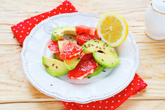 Fresh salad with avocado and grapefruit Royalty Free Stock Image