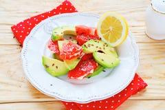 Fresh salad with avocado and grapefruit Royalty Free Stock Image