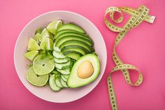 Fresh salad with avocado, green lime and cucumber Royalty Free Stock Images