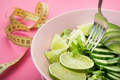 Fresh salad with avocado, green lime and cucumber Stock Photo
