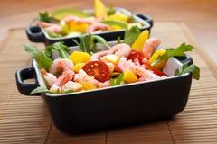 Fresh salad. Avocado , shrmips and mango on table matt Royalty Free Stock Images